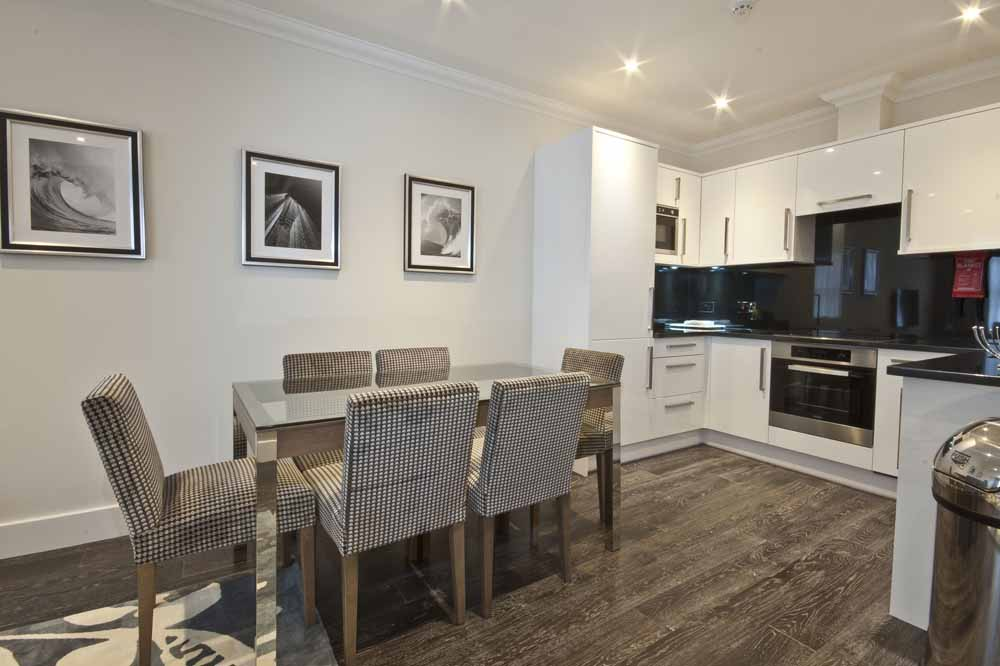Deluxe Three Bedroom Apartment - Kitchen and Dining Area