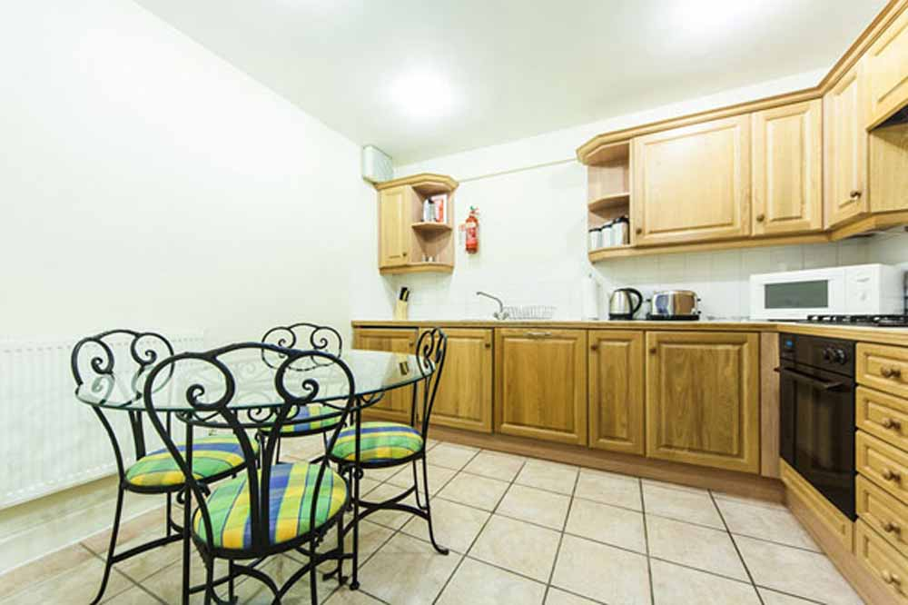 Standard One Bedroom Apartment - Kitchen and Dining Area