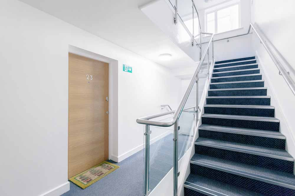 Abbots Place Apartments - Building Hallway and Staircase